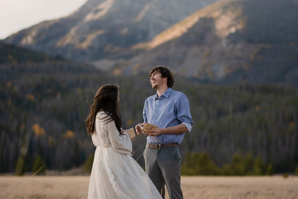 Laughing couple says their vows in Rocky Mountain National Park in Colorado