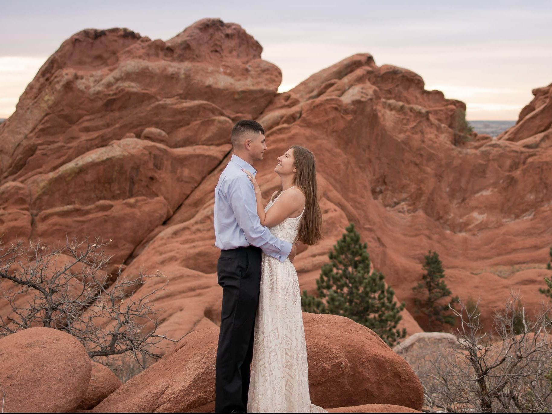 Bride and groom happily looking at each other in Garden of the Gods park in Colorado