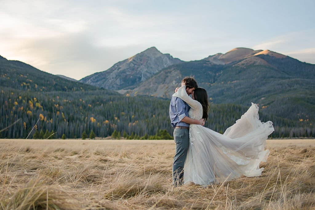 Wedding gown blowing in the wind during elopement in Rocky Mountain National Park in Colorado