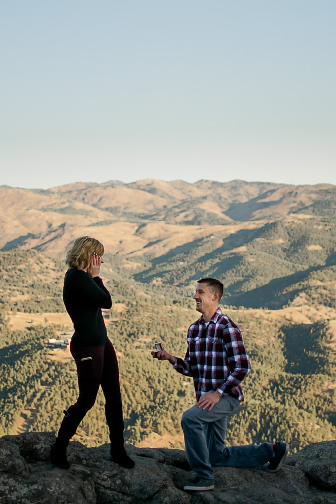 Man proposing to happy woman
