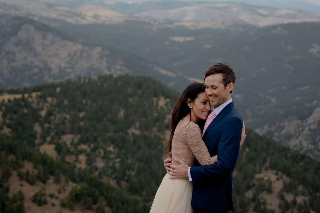 Bride and groom embracing at their Colorado elopement in Boulder