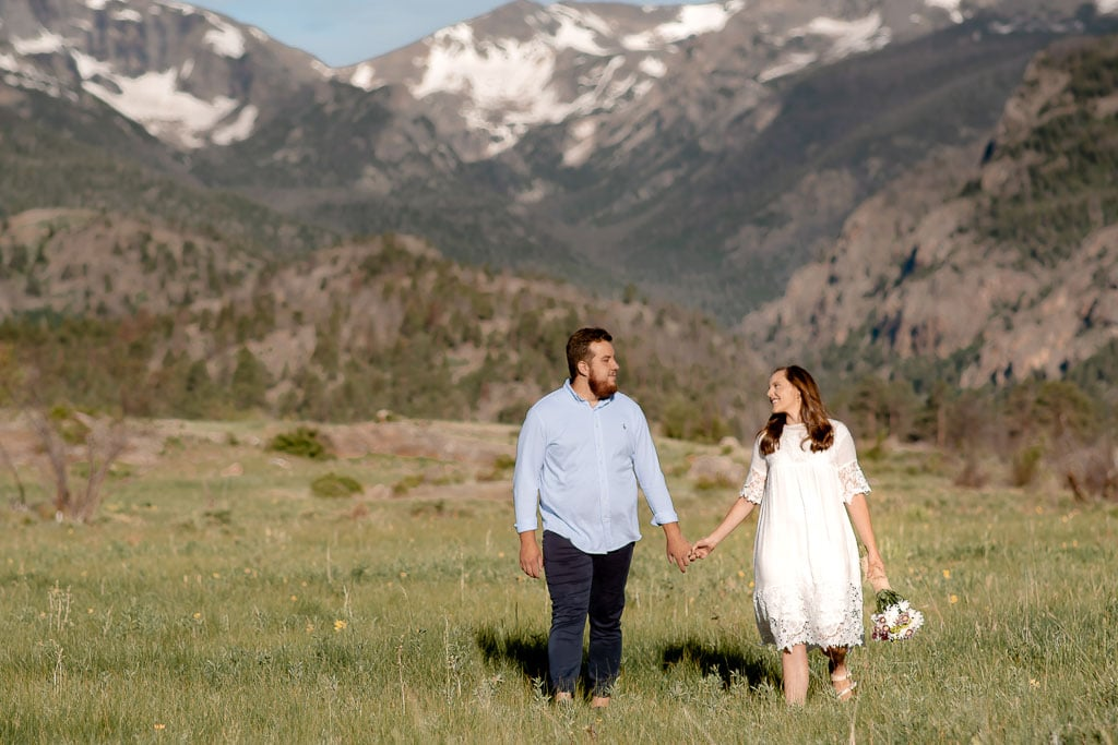 Couple holding hands during their Rocky Mountain National Park elopement