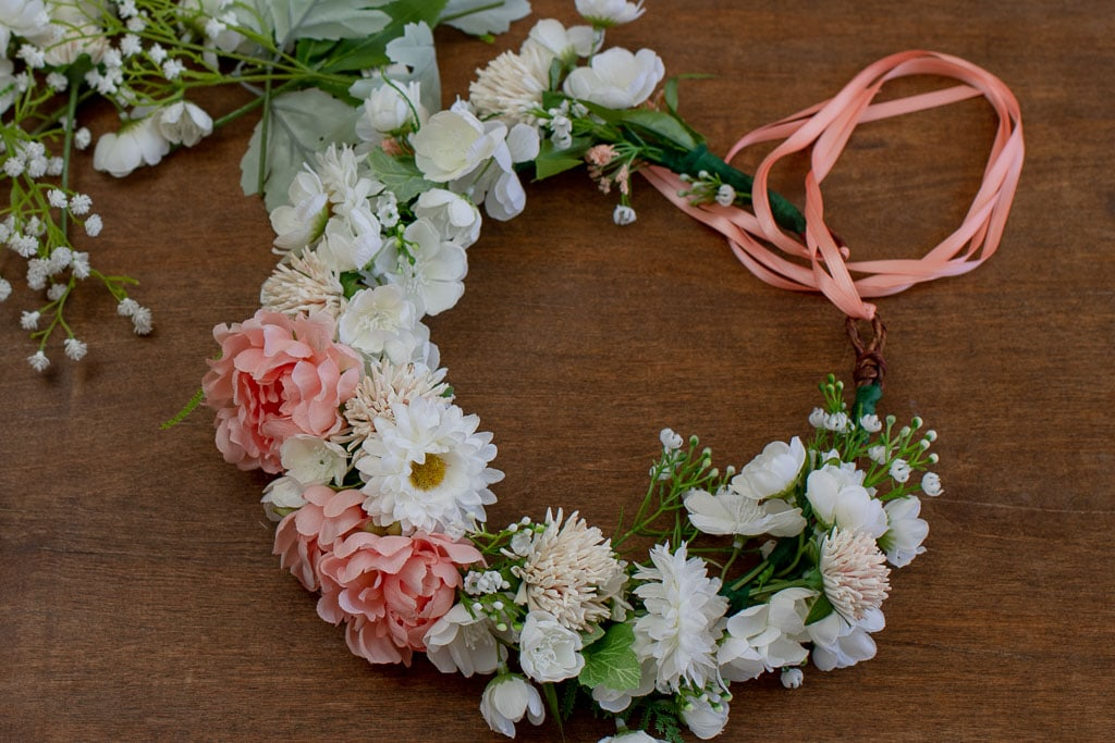 Pink and white flower crown with green leaves