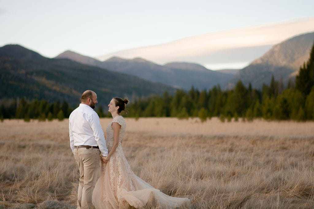 Rocky mountain national park elopement with bride and groom in front of mountain vista