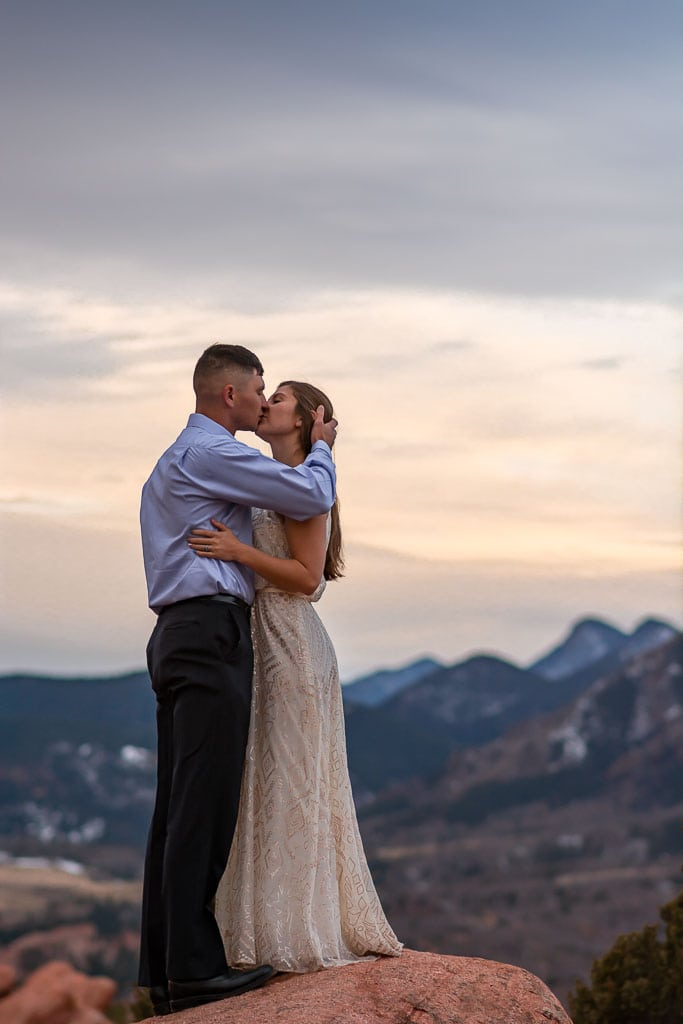 Couple gets married at sunrise in Garden of the Gods with Pikes Peak in the distance