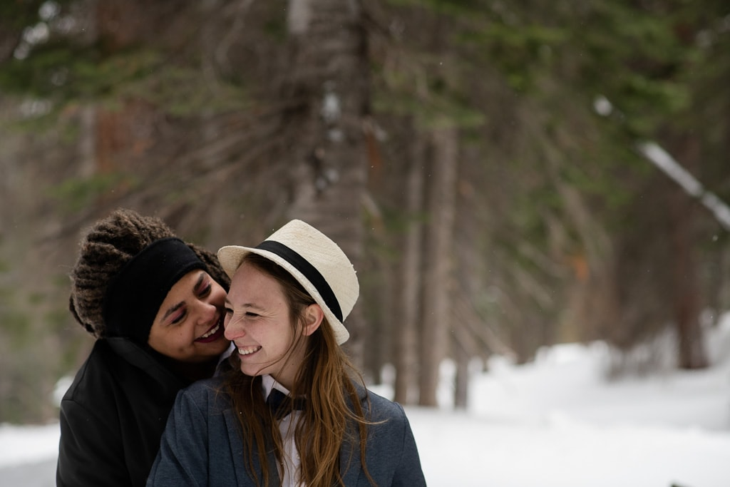 Same sex lesbian couple eloping in the wintertime in Colorado near Breckenridge