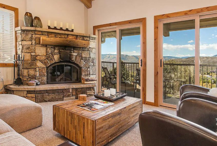 Snowmass Village Colorado Airbnb with a fireplace and patio with mountain views