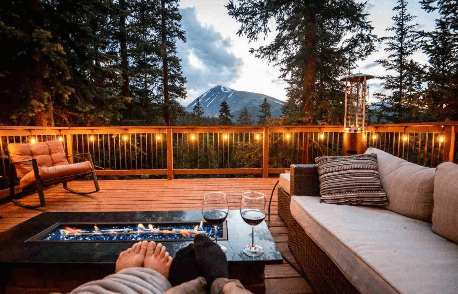 Breckenridge Airbnb cabin in the mountains with wooden deck and string lights