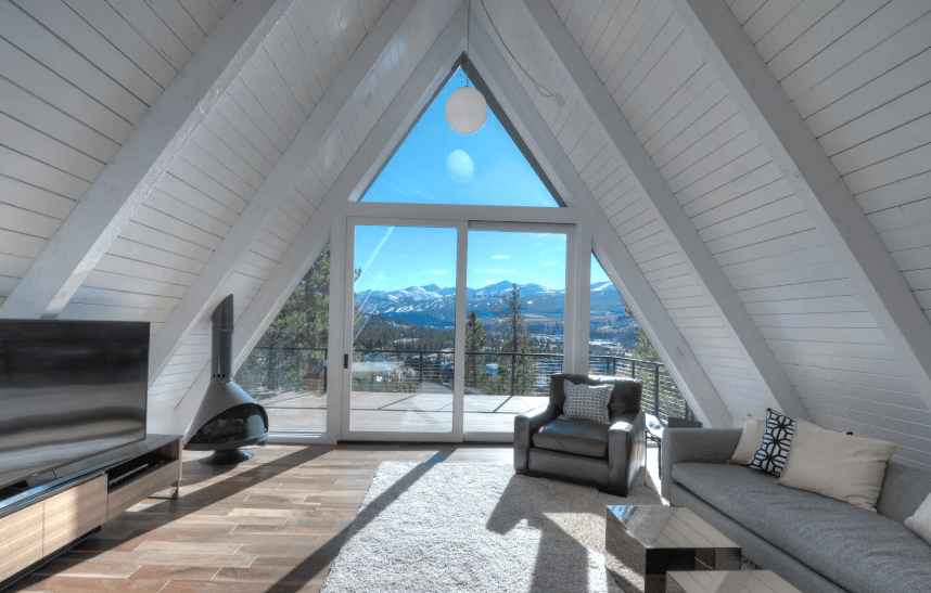 Modern white A-frame cabin in Breckenridge Colorado with mountain views