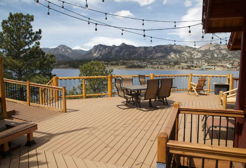 Estes Park Airbnb on Estes Lake with a patio with string lights and mountain views