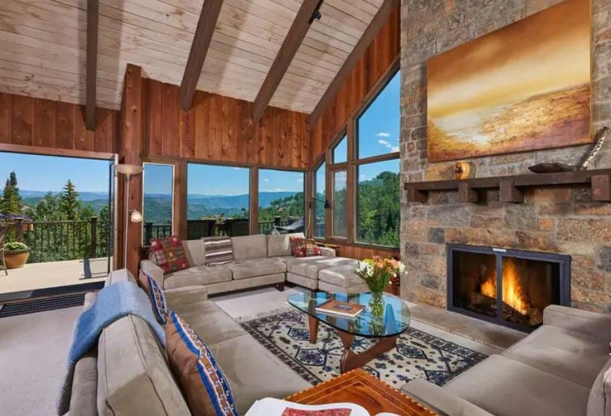 Colorado Airbnb with fireplace and modern furniture and mountain views