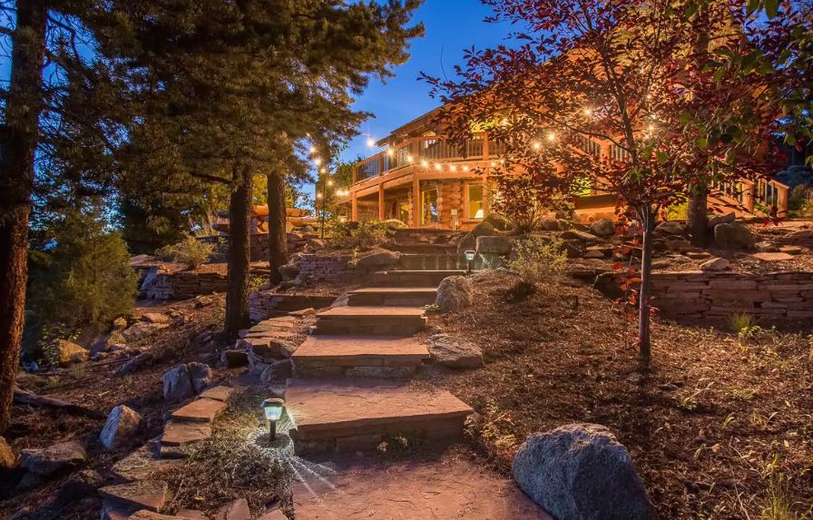 Airbnb for weddings with stone path and string lights