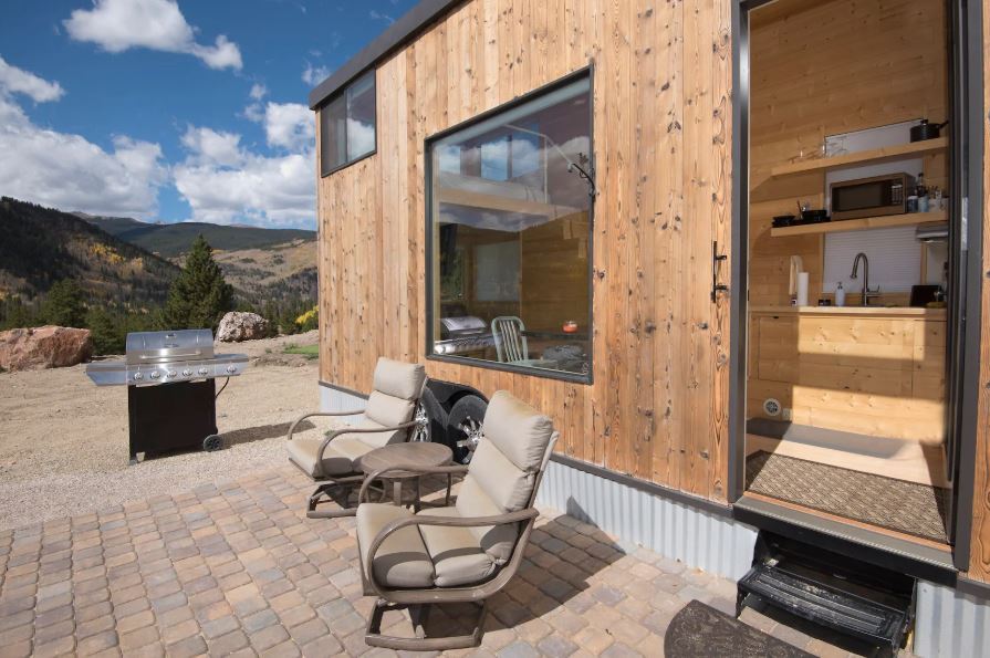 Tiny house Airbnb for rent with grill and beautiful mountain views near Vail, Colorado.