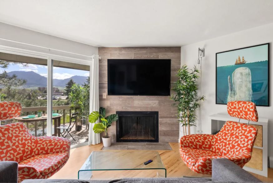 Modern condo with a fireplace and Boulder mountain views
