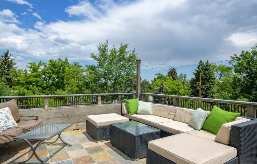 Outdoor patio with string lighting and couch in Boulder Colorado