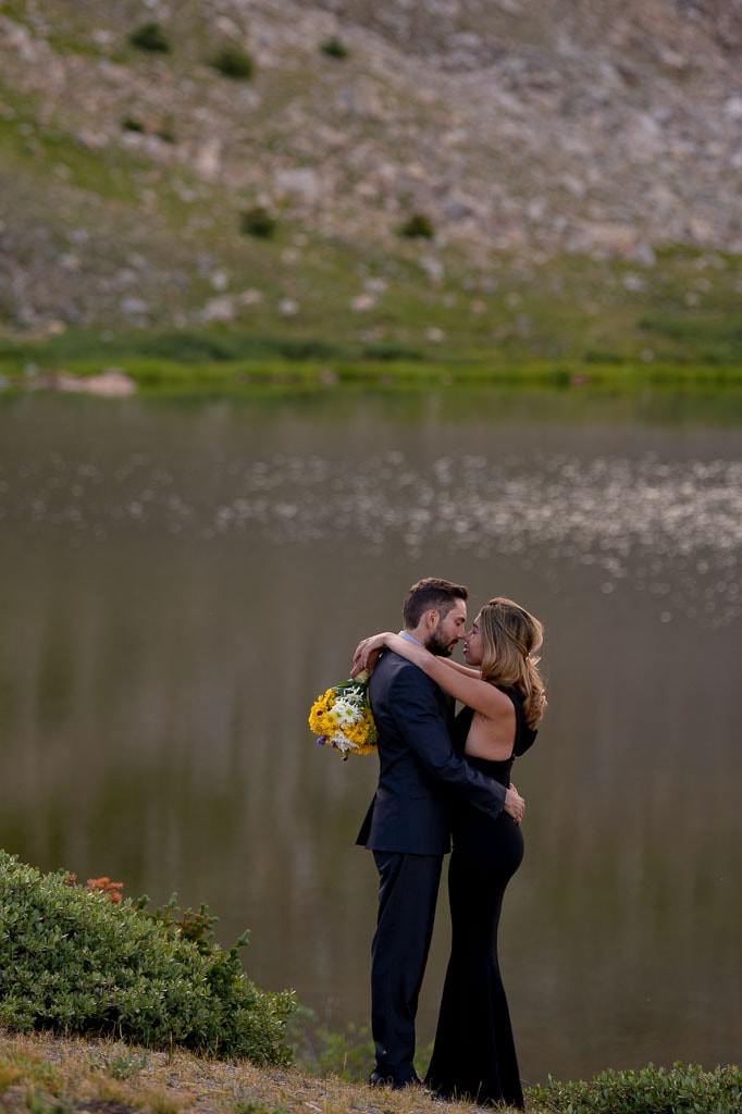 Eloping couple embracing at Loveland Pass