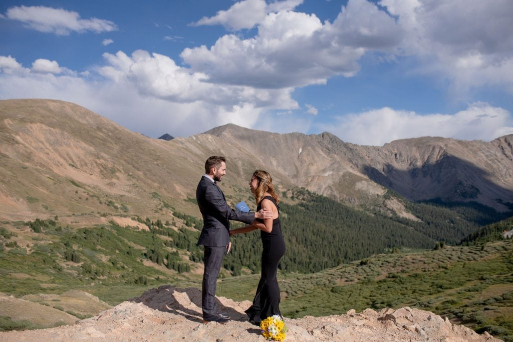 Eloping couple saying their vows to each other at Loveland Pass Colorado