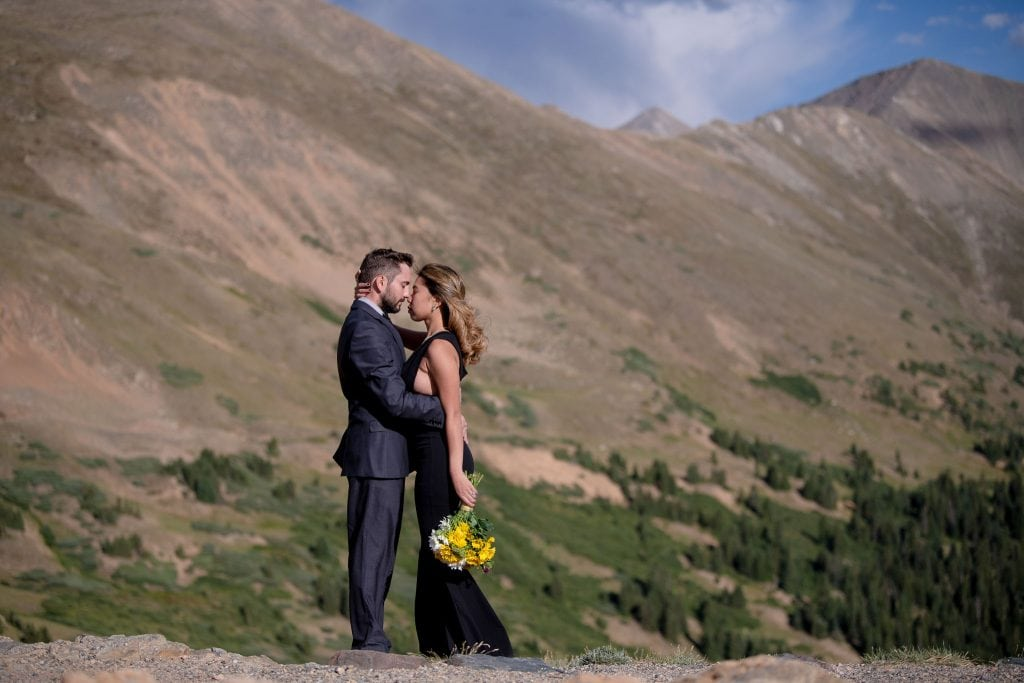 Eloping couple in Colorado holding each other during their Colorado hiking wedding