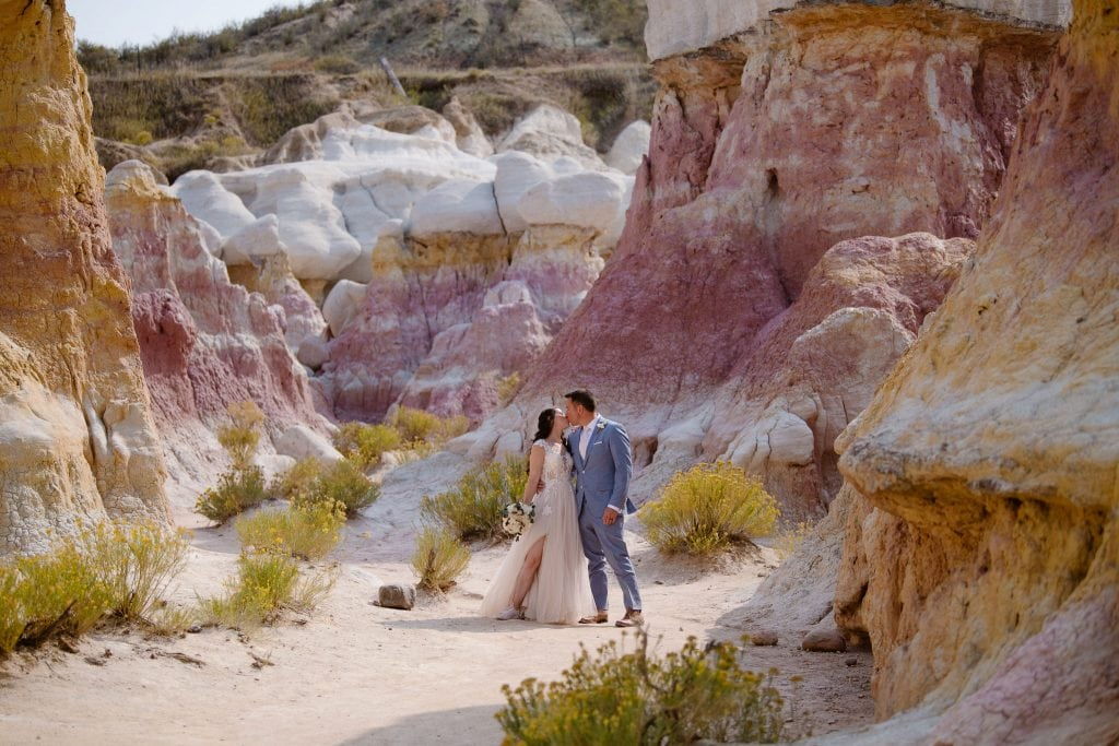 Couple kissing at their Paint Mines elopement in Colorado