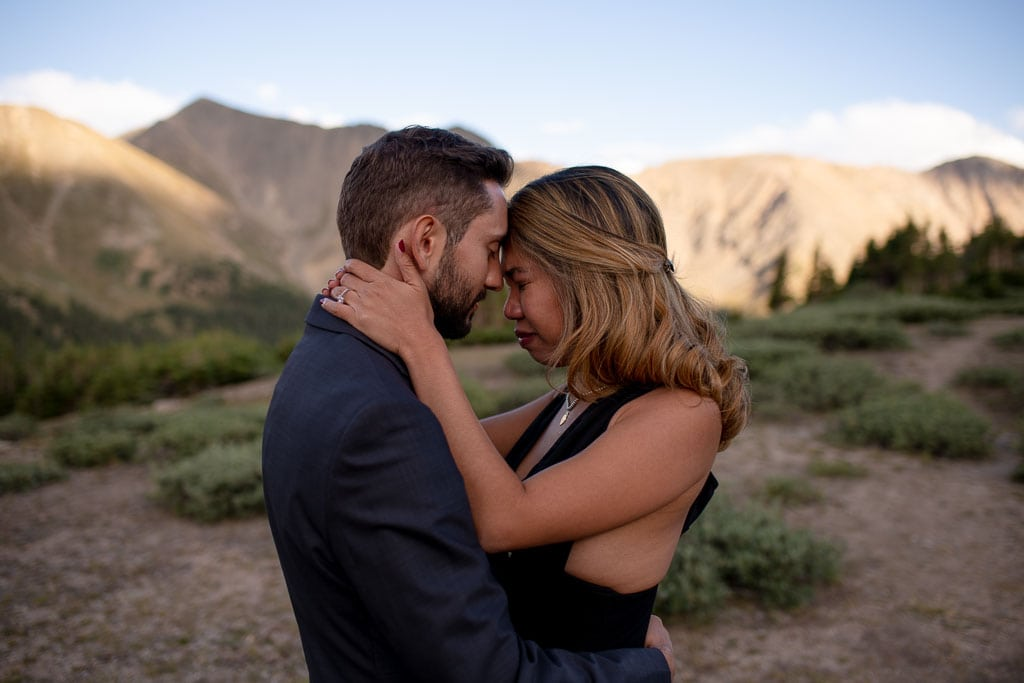 Emotional couple embracing at their elopement in the Colorado mountains