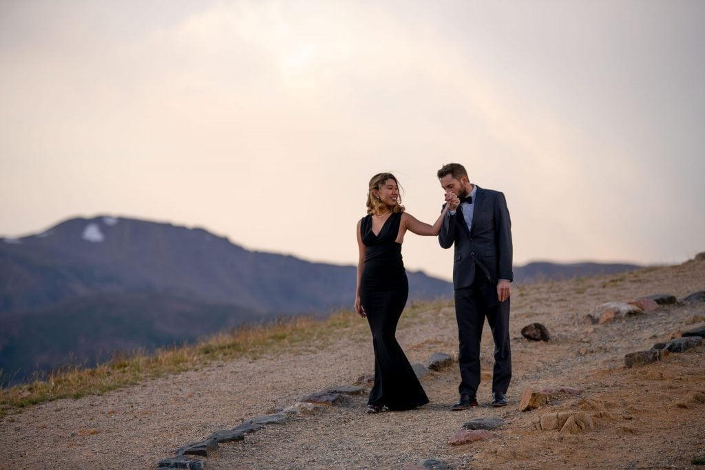 Bride and groom having their commitment ceremony in the mountains of Colorado