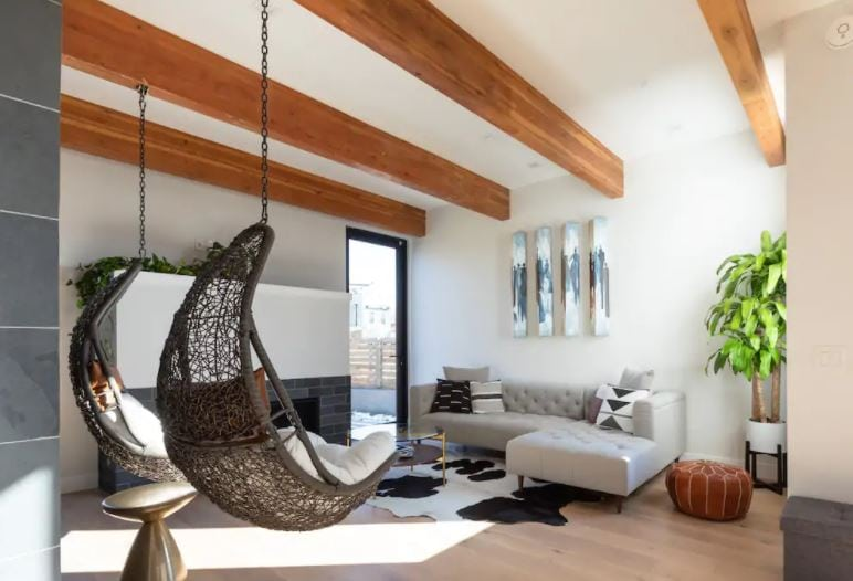 Living room of Denver loft with hanging chairs and modern couch