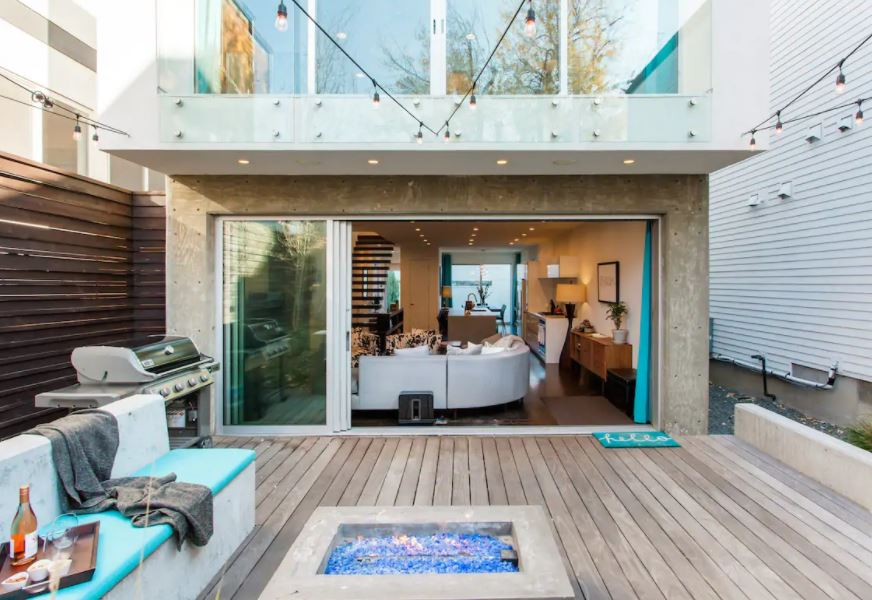 Outdoor patio with fireplace at a Denver modern townhome