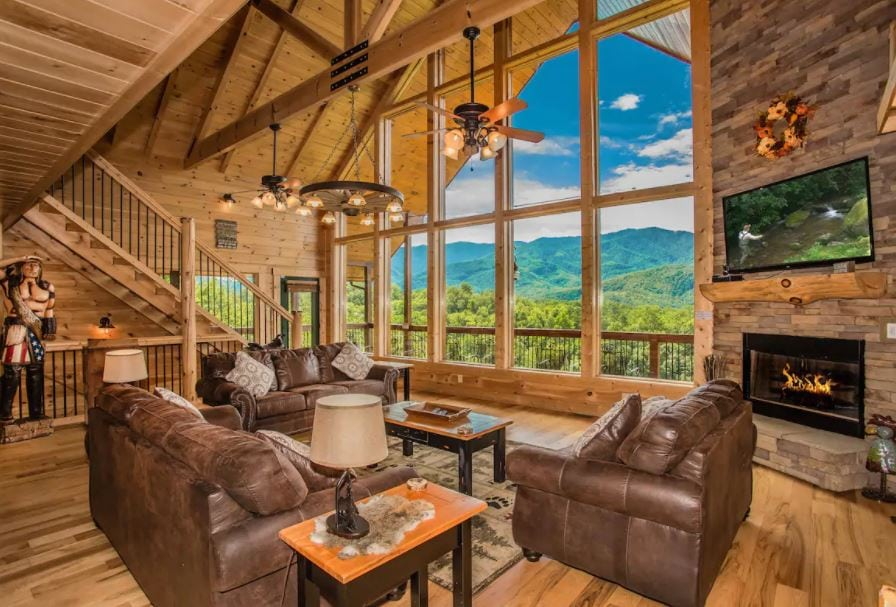 Large cabin Airbnb with floor to ceiling windows and mountain view