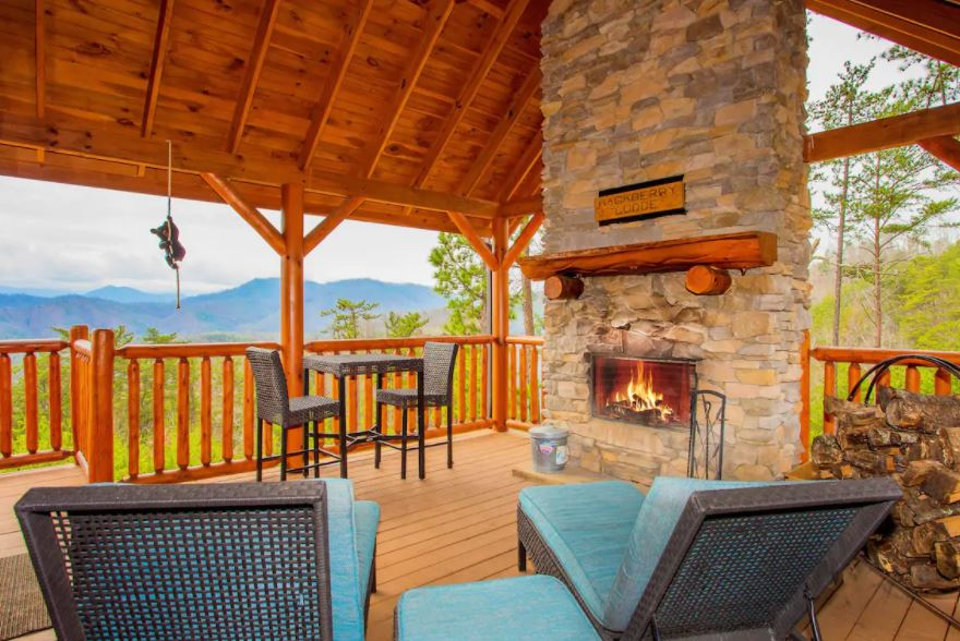 Patio of Gatlinburg Tennessee Airbnb with mountain views and a fireplace
