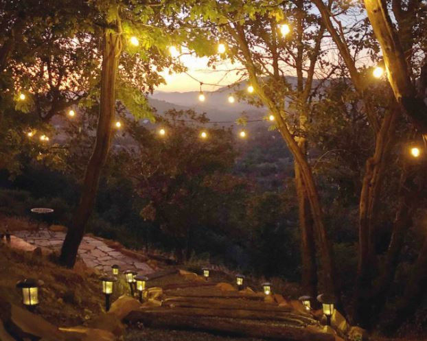 Airbnb for elopement with string lights in the trees and views of the mountains