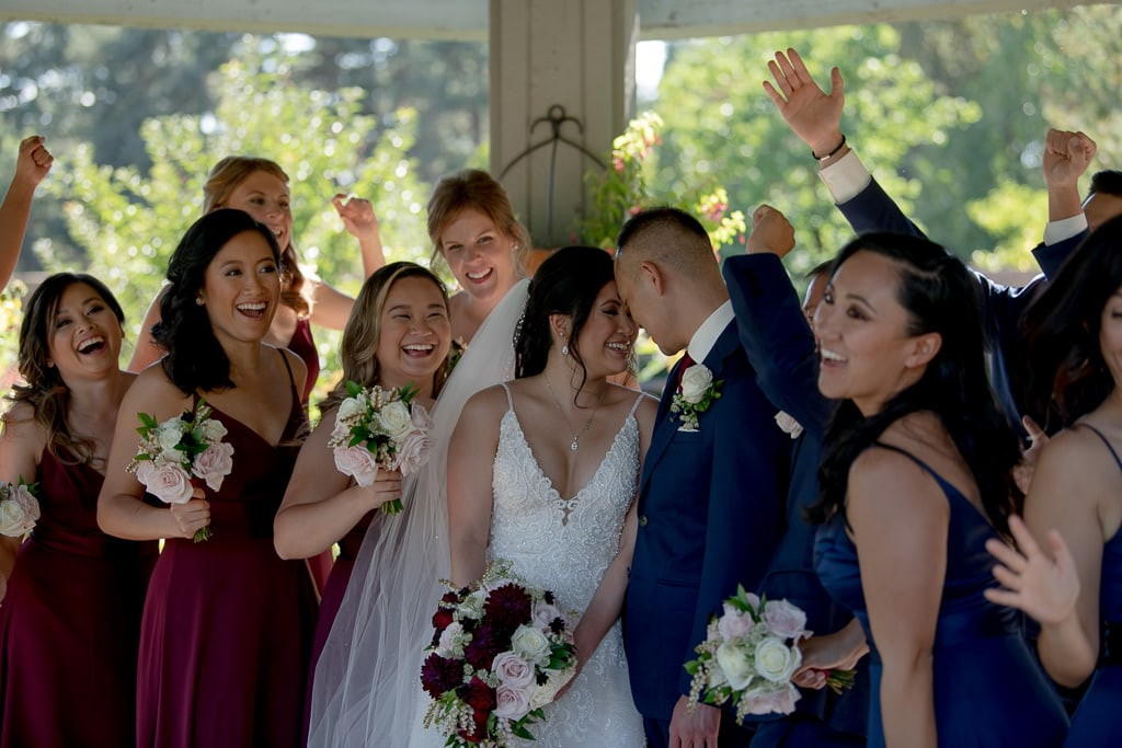 Bride and groom surrounded by their bridal party at their Texas Airbnb Wedding