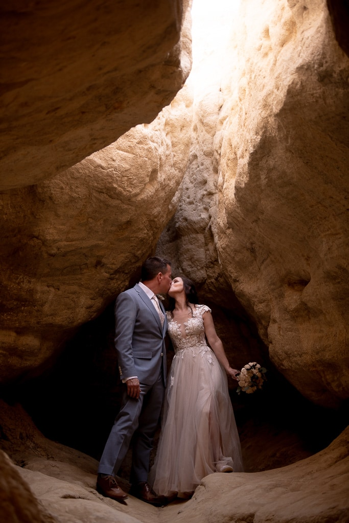 Photo of eloping couple kissing taken by Colorado Elopement Photographer Wild and Found Photography
