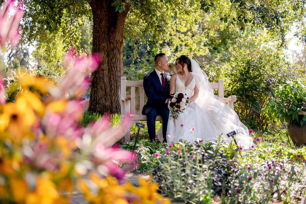Colorado Denver botanic gardens elopement with bride and groom sitting on a bench