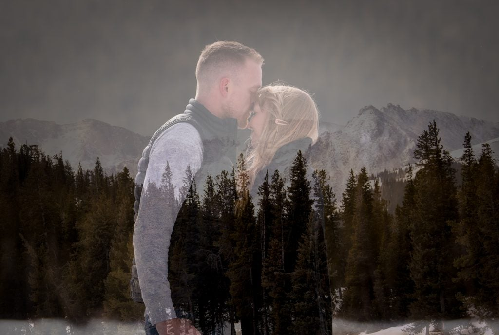 Newly engaged couple embracing each other with an overlay of mountains and trees in Colorado