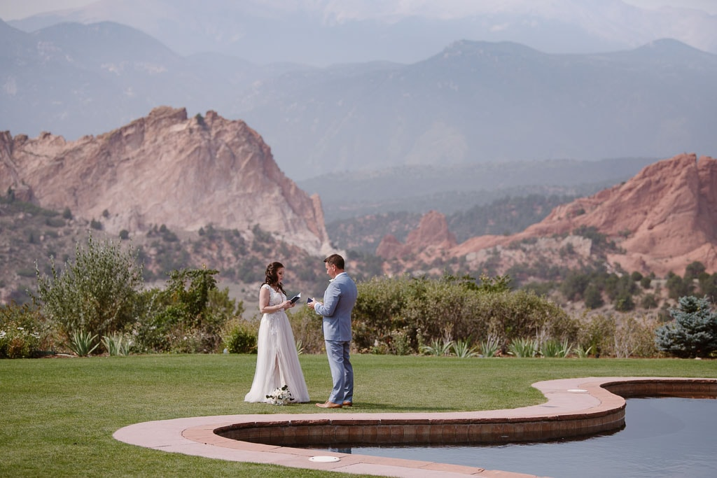 Bride and groom saying their vows by the reflecting pool at Garden of the Gods resort in Colorado Springs