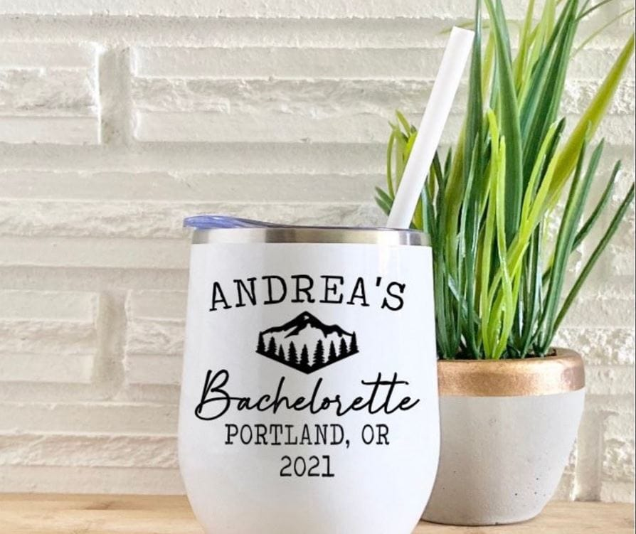 """White wine tumbler with a mountain on in it and words """"Andrea's Bachelorette"""""""