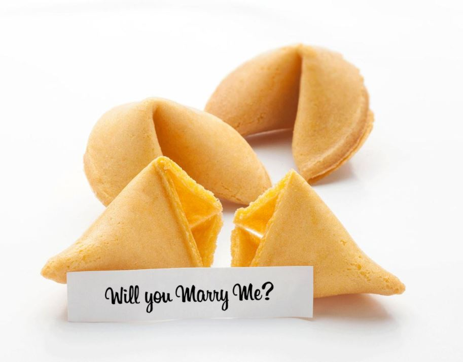 """Three fortune cookies on a white background with a fortune that reads """"Will You Marry Me?"""""""