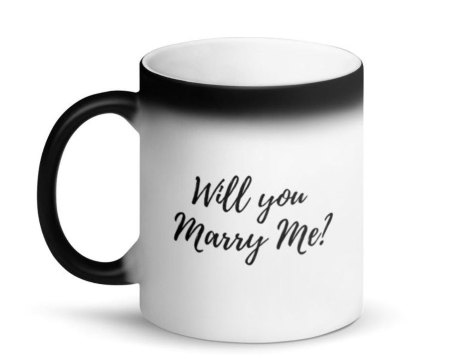 White mug that changes to black when hot with hidden Will You Marry Me? message on the side of the mug