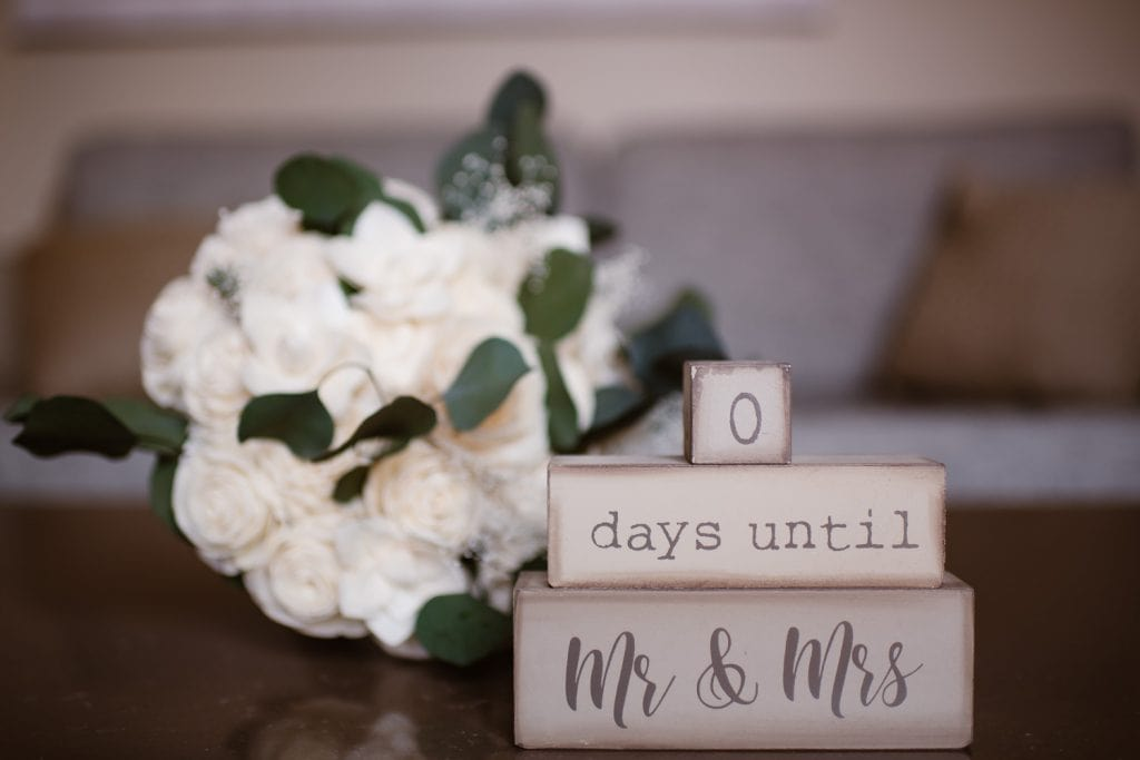 Blocks that show a countdown of days until Mr & Mrs with a bouquet of flowers in the background